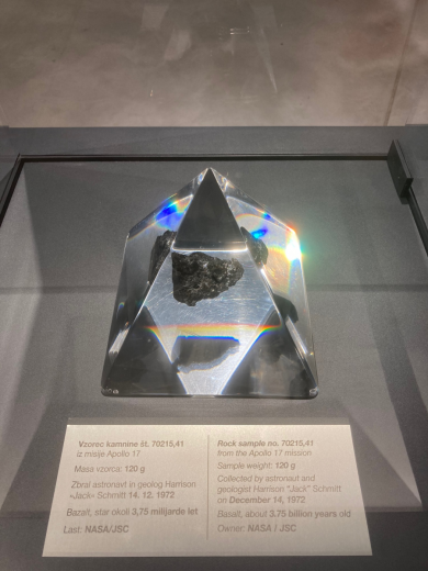 Black stone in a transparent pyramid.