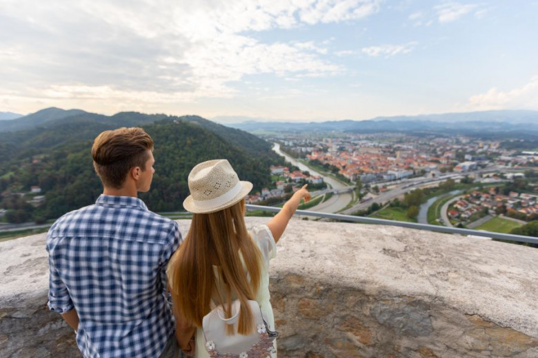 Young couple enjoys the view over Celje from the Old Castle Drazen Stader Produkcija Studio slovenia.info